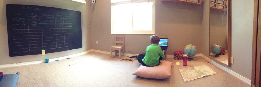 boy in a playroom traveling virtually across the country on Google Maps