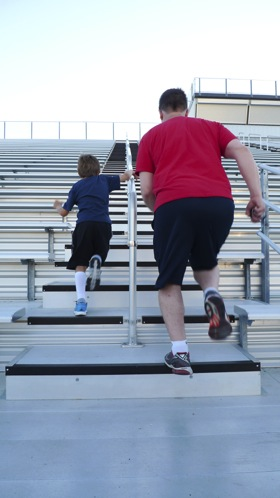 Joaquin and papa race up the bleachers