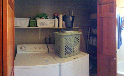 Laundry closet before remodel shows a shelf over the appliances