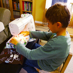 Joaquin using a sewing machine
