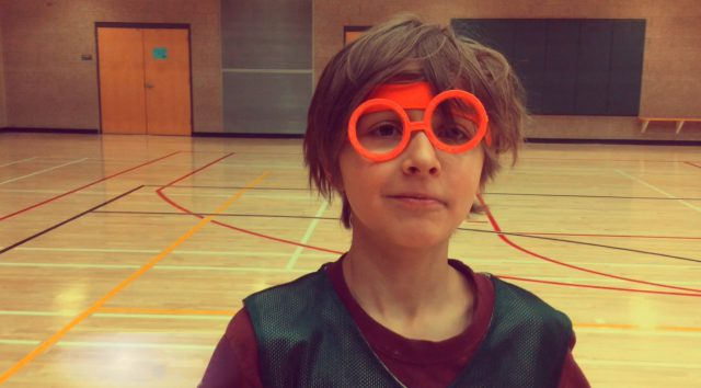 Joaquin in the basketball court wearing costume eyeglasses