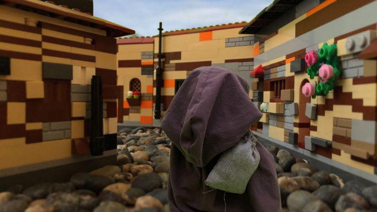 Composite image of a homeless stuffed bear in a street inside our micro lego set