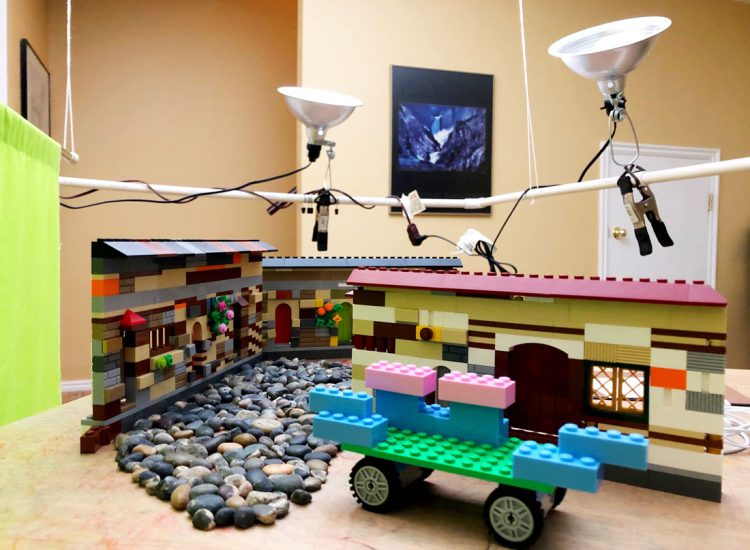 Our lego stage, camera dolly, and lights ready for shooting