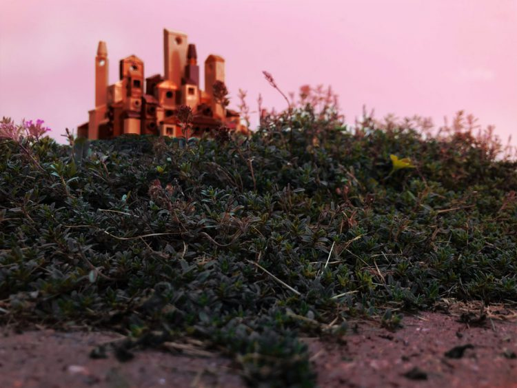 Micro lego town in the pink light of sunrise