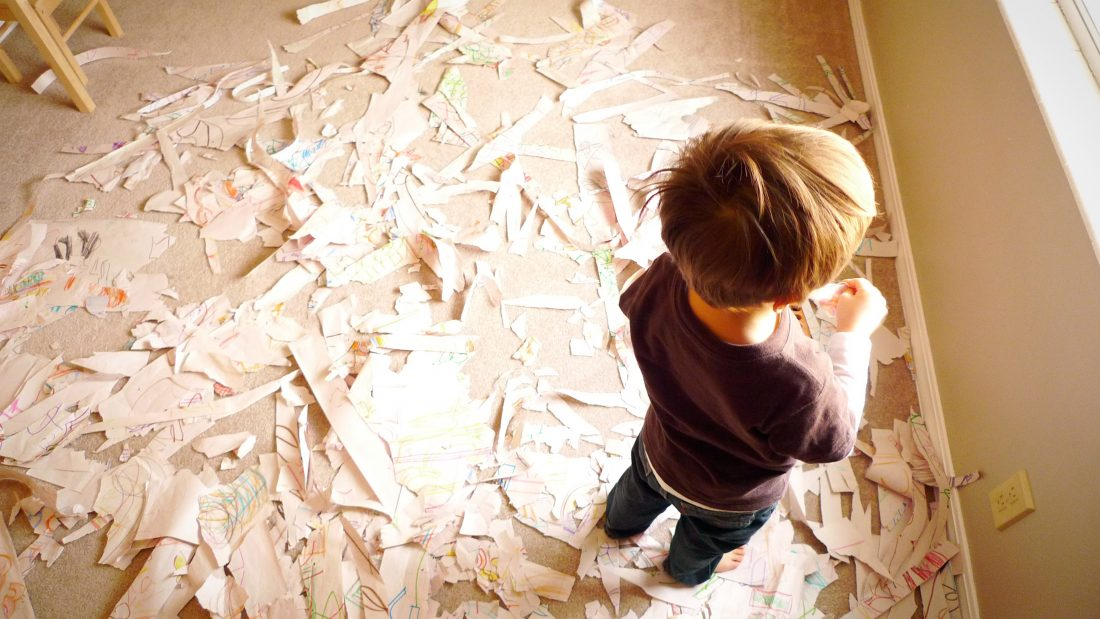 3-year-old surrounded by a roomfull of shredded paper