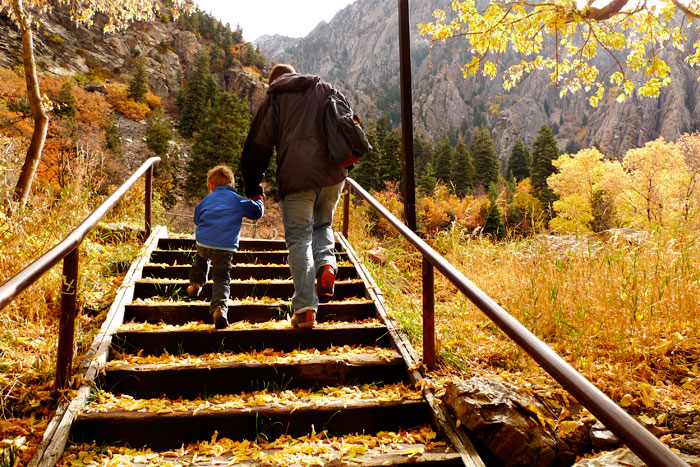 2-year-old Joaquin and papa climbing stairs among the glory of Utah's fall landscape